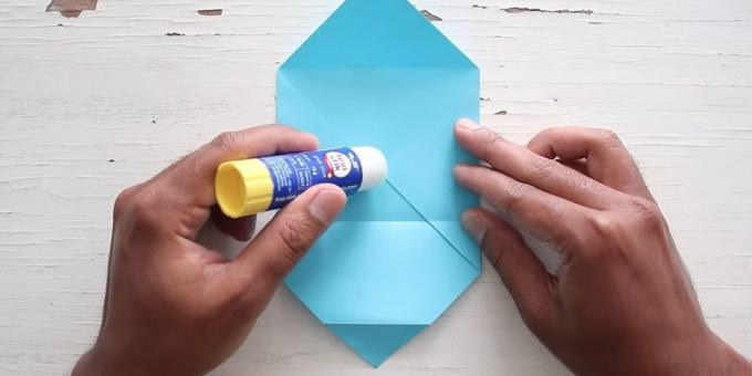 envelope with your hands: grease the paper with glue
