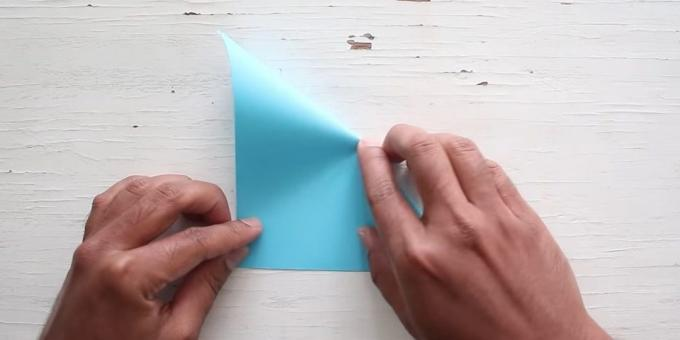 envelope with your hands: bend the paper in the opposite direction