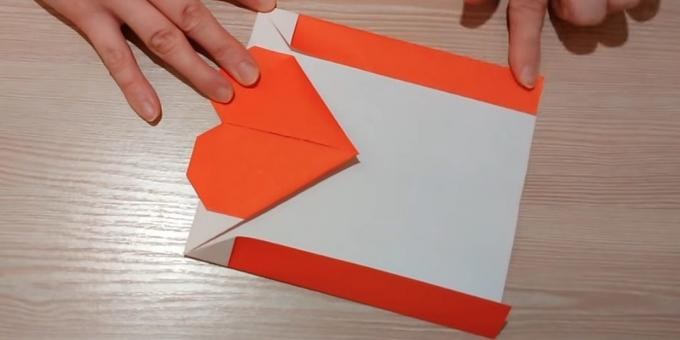 Turn the paper over and fold the side edges