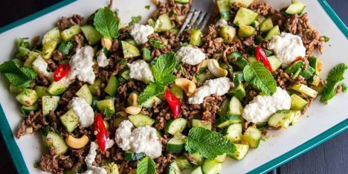 Cucumber salad. Salad with cucumbers, spicy beef and walnut dressing
