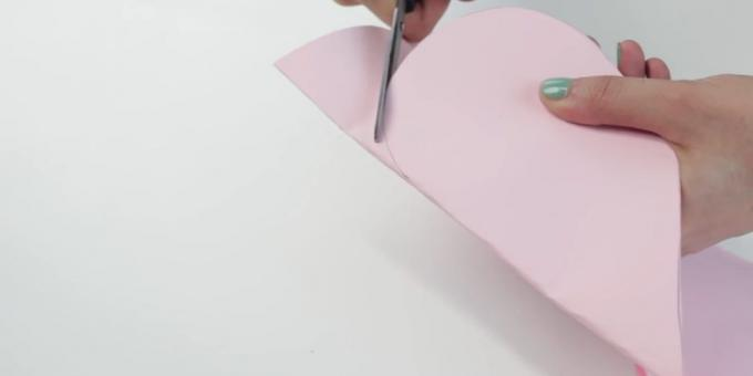 envelope with your hands: heart cut out of paper